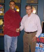 Blacknews tony rose of amber communications signs ebook tony rose publisher and ceo of amber communications shakes hands with philip kives president and founder of k tel international fandeluxe Choice Image