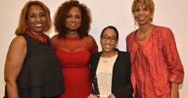 Nzinga Braswell with staff members at Delta sigma Theta Film Festival