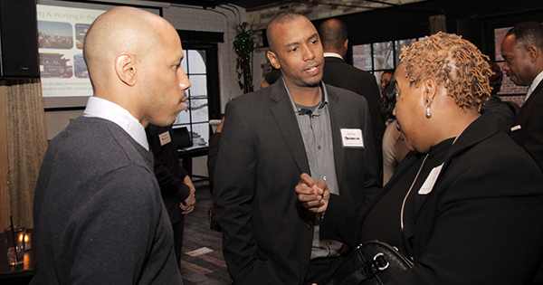 Will Moss, founder of HBCU Connect, networking with attendees to his company's event