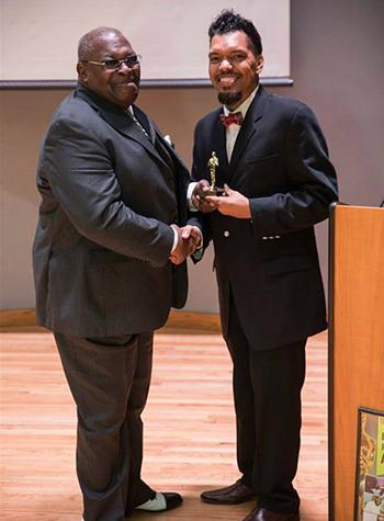 Composer Stu Gardner receiving award
