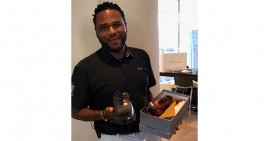 Anthony Anderson with a pair of Tuccipolo Shoes