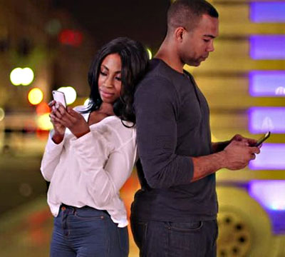 African American couple using smartphones