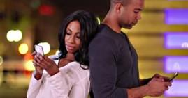 African American couple using smartphones