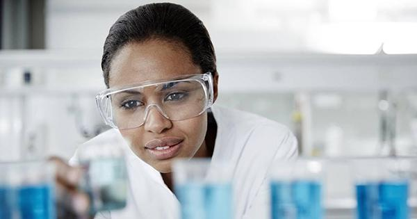 Black college graduate in a science lab