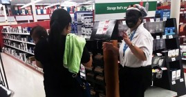 Woman with black face at Staples