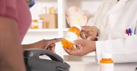 African American buying medicine