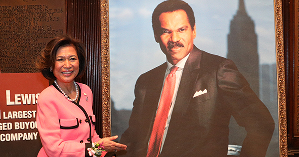Loida Lewis with a photo of her late husband, Reginald F. Lewis