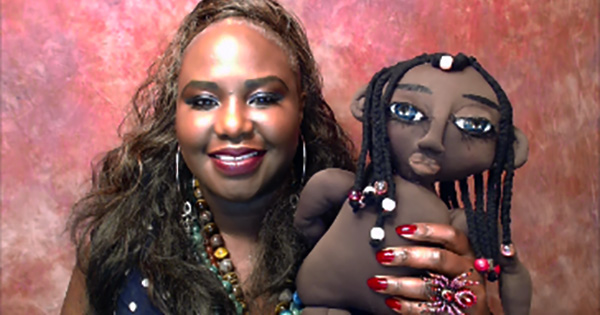 Dr. Cassandra George Sturges holding her Maggy Rag doll