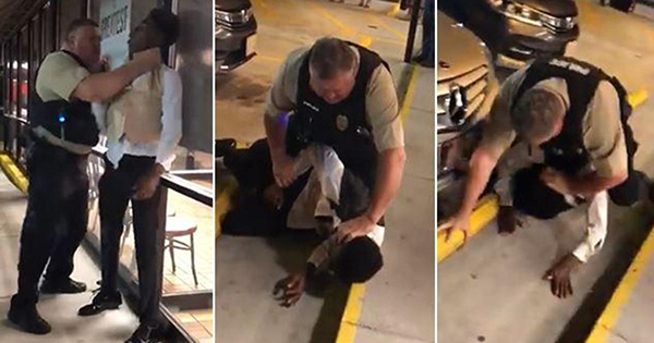 Police officer chocking Black man outside Waffle House