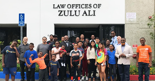 Children in front of the Law Offices of Zulu Ali