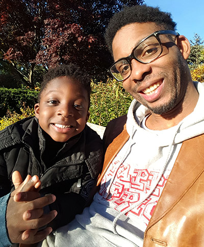 A.D. Largie, founder of Kemet Kids Publishing, with his 4-year old son