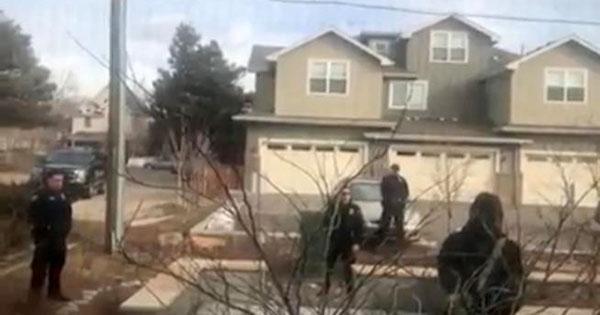 Police officers surround Black man picking up trash in Boulder, Colorado