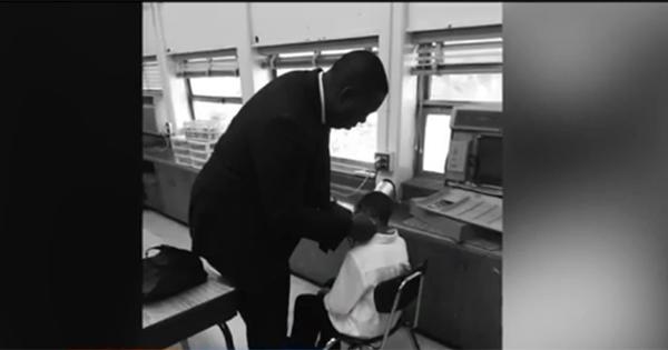 Robert Dunham, teacher giving his student a haircut